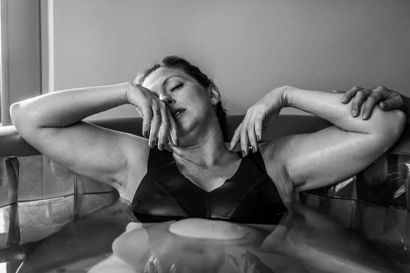 Denver Doula Service, black and white image of woman in birthing tub
